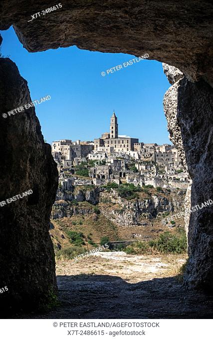 Looking to the town of Matera from the chiese rupestri, caves, across the gorge, Basilicata, Southern Italy