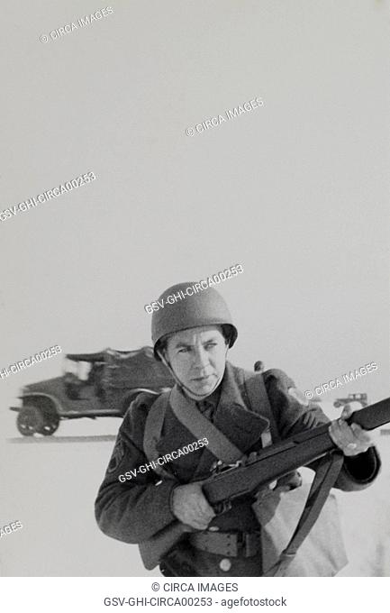 Military Soldier in Uniform Pointing Rifle Portrait, WWII, HQ 2nd Battalion, 389th Infantry, US Army Military Base, Indiana, USA, 1942