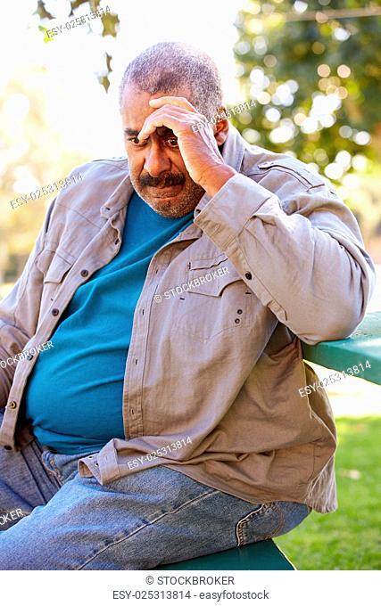 Depressed Senior Man Sitting Outside