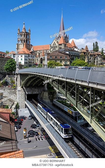 View from rue Centrale on Pont Charles-Bessières bridge with Métro and Notre-Dame Cathedral with old town, Lausanne, canton of Vaud, Western Switzerland