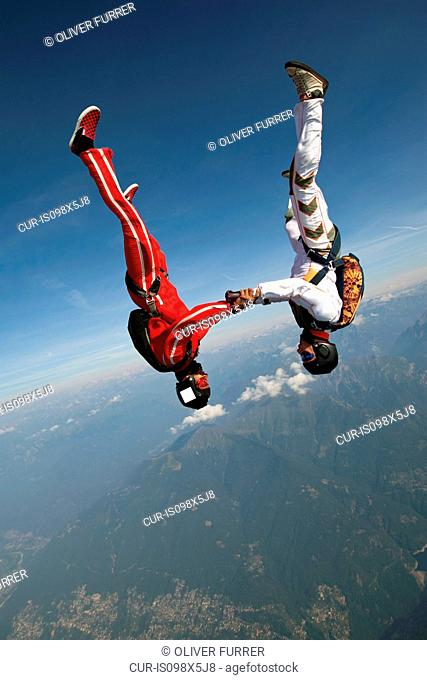 Skydivers freeflying over Locarno, Tessin, Switzerland