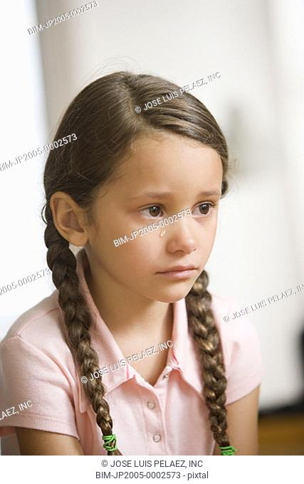 Young girl crying