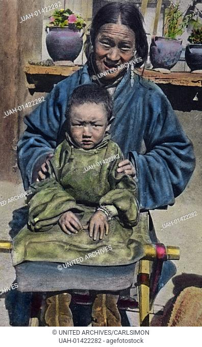 Tibet, Portrait of Mother and Son - the young brother of Tashi Lama (Panchem Lama). Image date: circa 1920. Carl Simon Archive