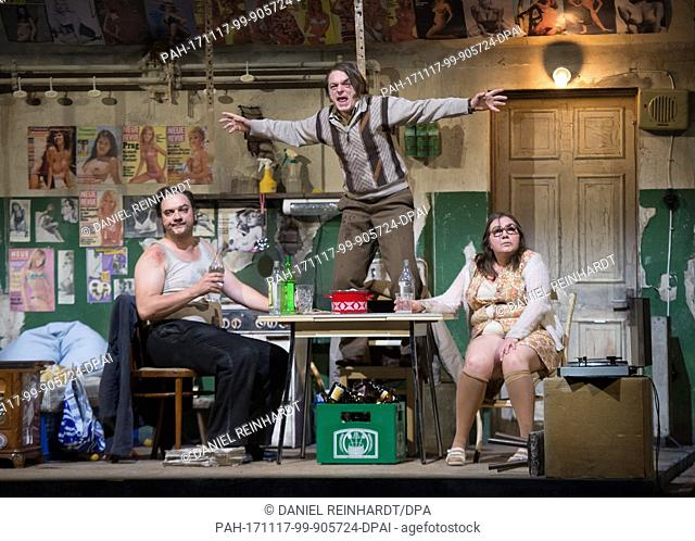 "Charly Hubner (Fritz """"Fiete"""" Honka, L), Michael Weber (Brother Siggi) and Bettina Stucky (Gerda Voss) performing onstage during a photo rehearsal of the play..."
