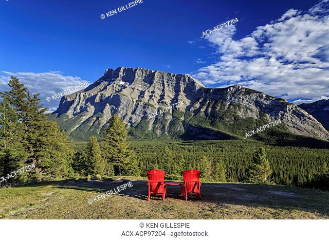 Adirondack chairs overlooking Mount Rundle, from Tunnel Mountain viewpoint, Banff National Park, Alberta, Canada. (Part of the Parks Canada red chair program)