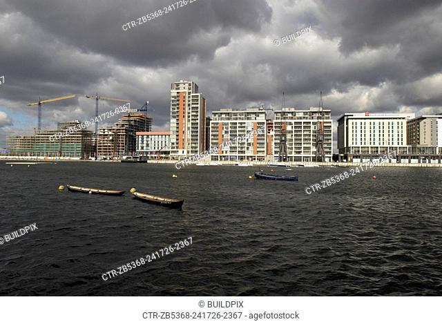 Thames River in front of construction work at the Royal Victoria Dock, East London, UK