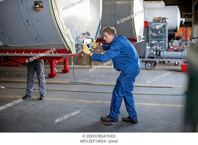 Industrial worker checking containers settings