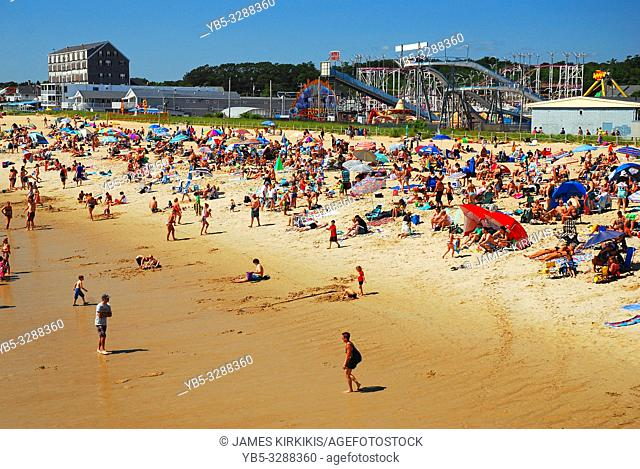 A crowd covets the sunâ. . s rays at Old Orchard beach, Maine