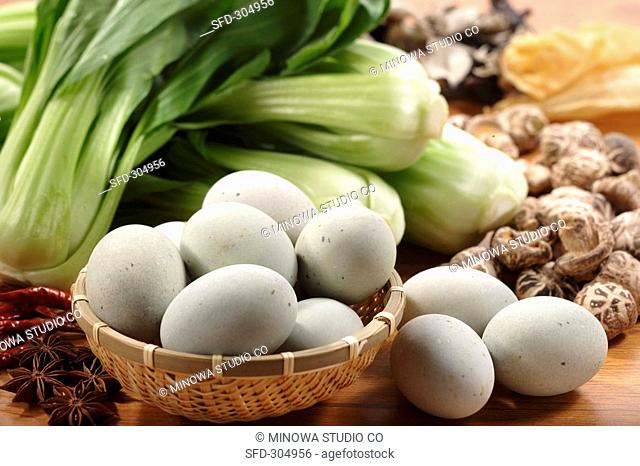 Chinese century eggs, spices, pak choi, shiitake