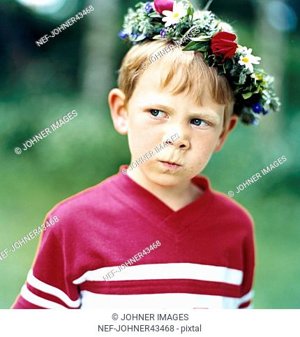 Angry boy with Midsummer wreath on his head