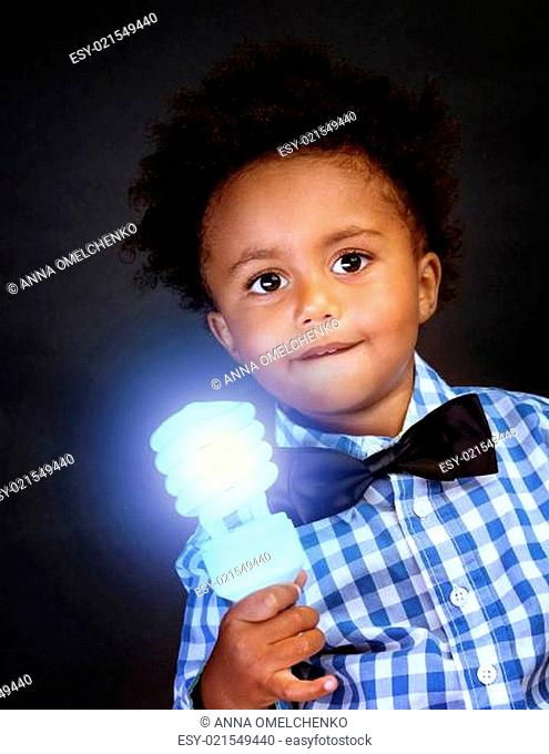 Little genius with illuminated lamp