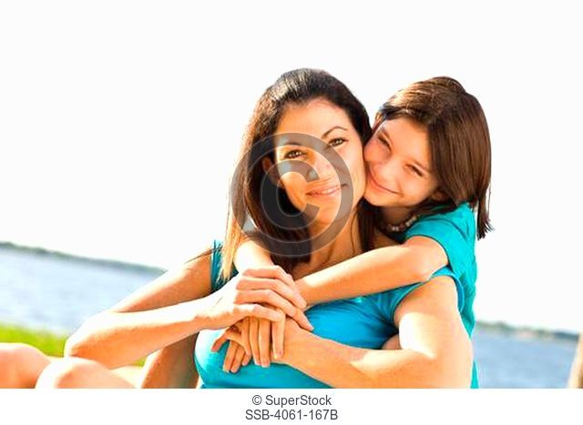 Girl smiling with her mother
