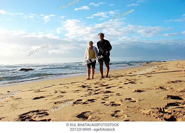 A couple on a beach along the Indian Ocean, the Garden Route, Kwazulu Natal, South Africa