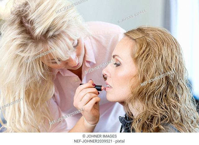 Young woman having make-up