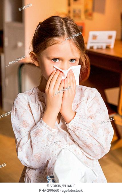 5 year-old girl blowing nose