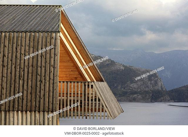 Preikestolen Mountain Lodge, Strand, Norway. Architect Helen & Hard, 2008. Detail of west elevation with balcony and Lyse fjord in evening sun