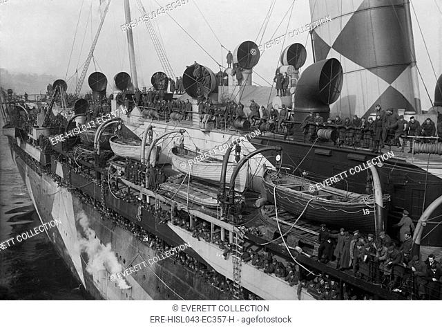 RMS Mauretania transporting American soldiers, Dec. 2, 1918 in New York Harbor. The luxury ocean liner was similar to her running mate, the Lusitania