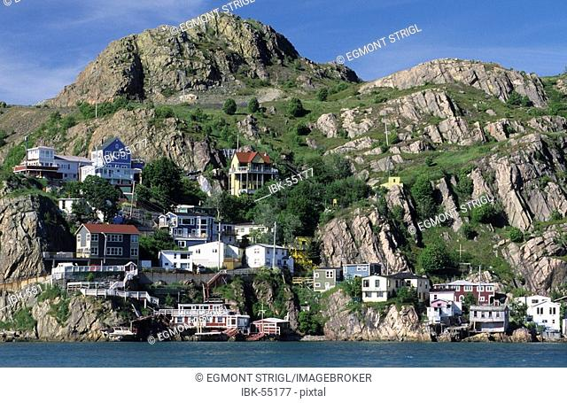 Houses and fishing boats in the harbor of St John's, Newfoundland, CAN