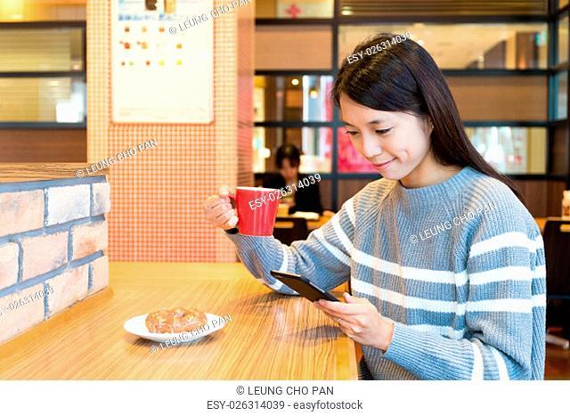 Woman enjoy her breakfast in coffee shop