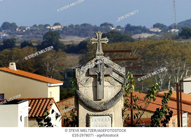 The view from a cemetery of a cross and the Peyne river valley, Pézenas , Herault, France