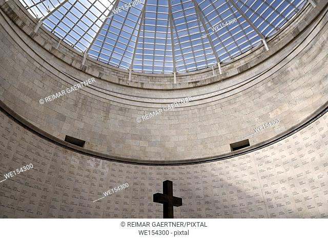 Cross under skylight in central tower with names of the interred at the war memorial for the fallen of World War I at Oslavia Italy
