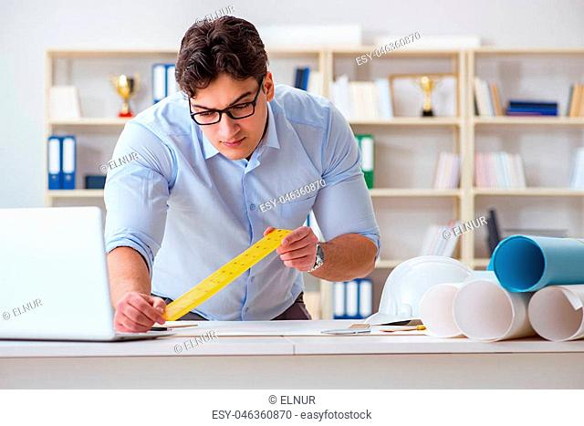 Male engineer working on drawings and blueprints
