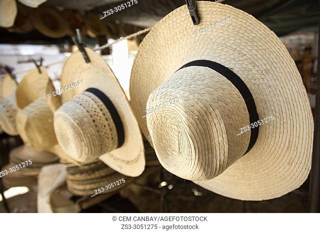 Panama hats for sale at the open-air street market in the city center, Trinidad, Sancti Spiritu Province, Cuba, Central America