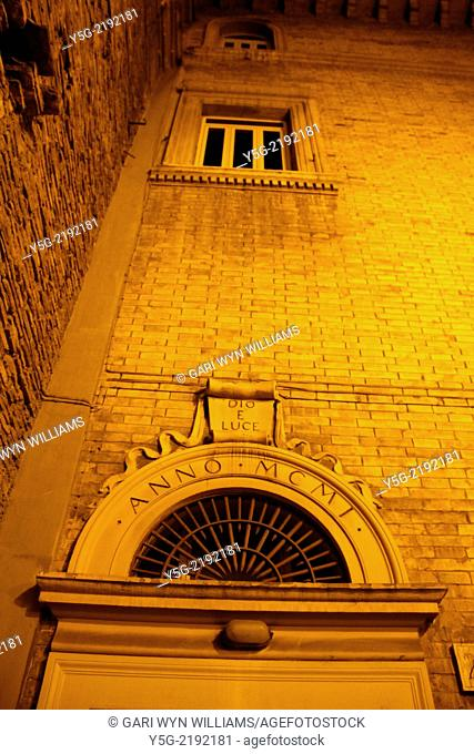 church door in the trastevere district in rome italy