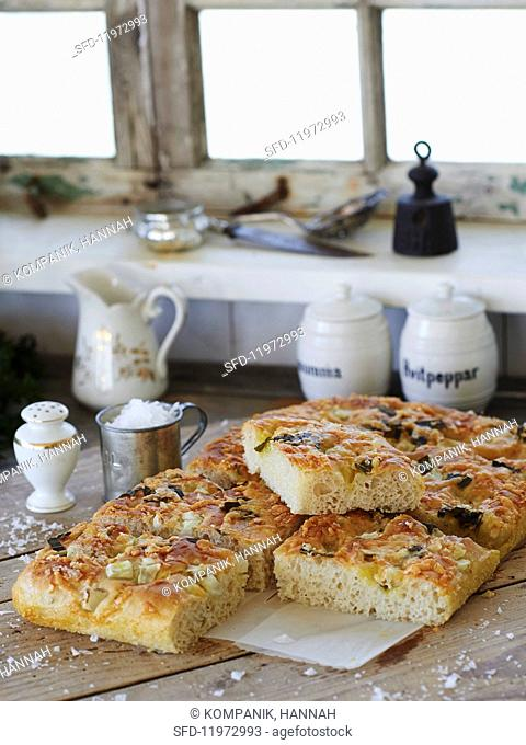 Focaccia topped with vegetables and coarse sea salt