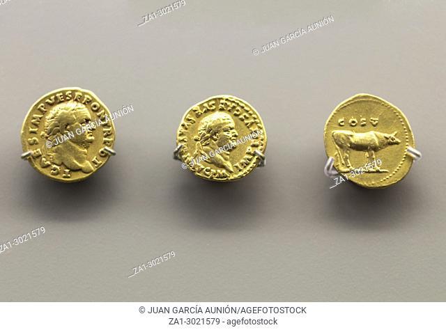 Merida, Spain: Three golden coins of Titus Emperor at National Museum of Roman Art in Merida, Spain