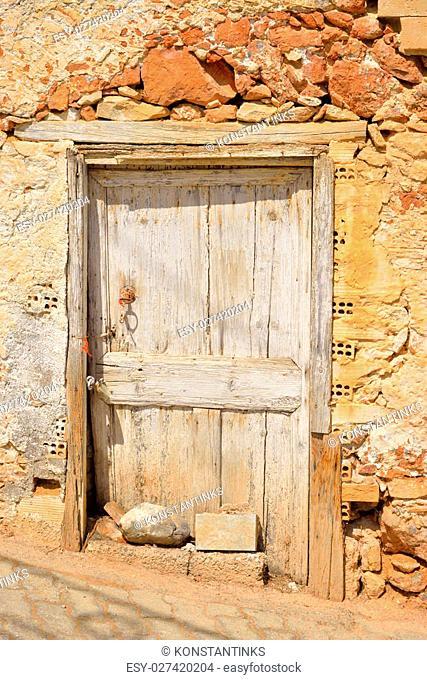 Door of old building in Hersonissos on Crete, Greece