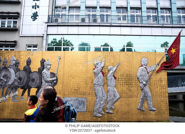 Heroic murals outside a primary (elementary) school in Chengdu, Sichuan, China