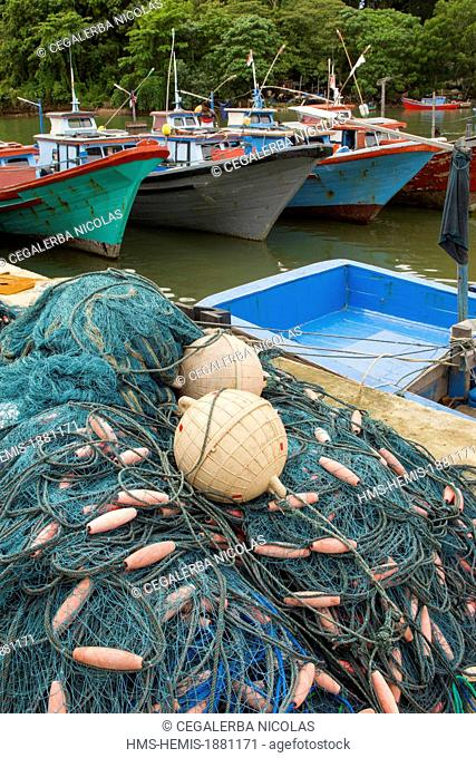 Indonesia, Sumatra Island, Aceh province, Calang, Fishnets and fishing boats in Calang harbor
