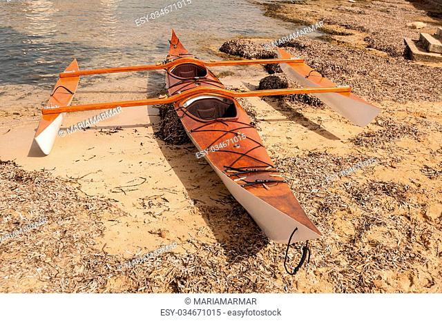 Double kayak with skates on sand