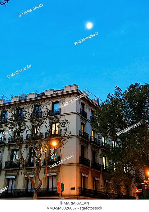 Facade of house and moon. Independencia Square, Madrid, Spain