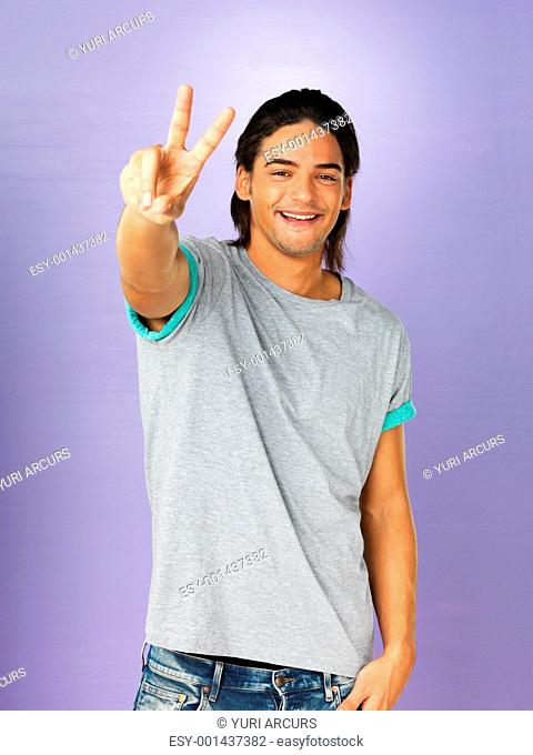 Handsome man giving peace sign