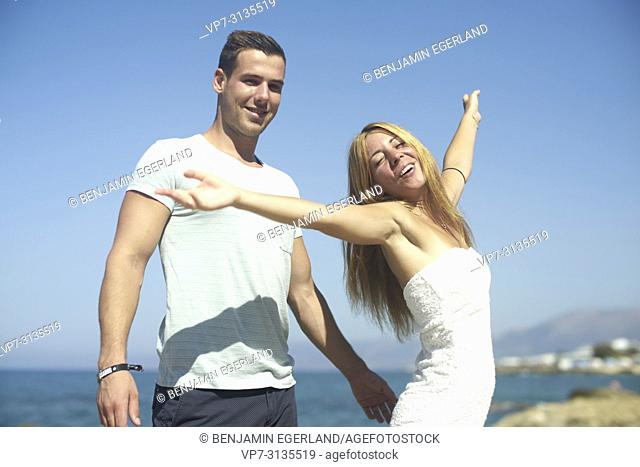 Couple in summer holiday, dancing. Crete, Greece