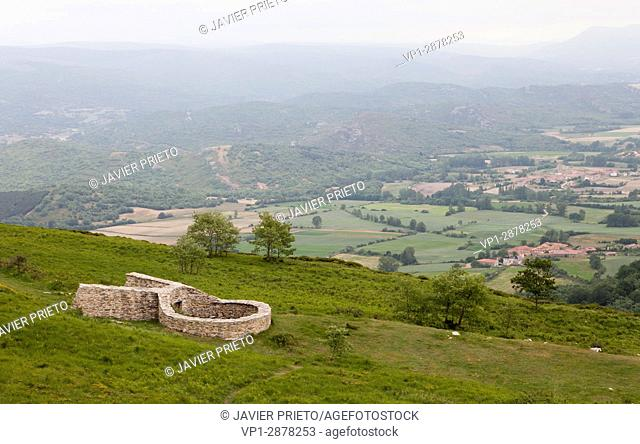 Reconstruction of the Wolves' Well of the Paramo de la Lora. A circular well surrounded by a stone fence was the point where the wolves were harassed to end up...