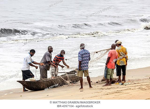 Fishermen prepare a net for fishing, Kribi, South Region, Cameroon