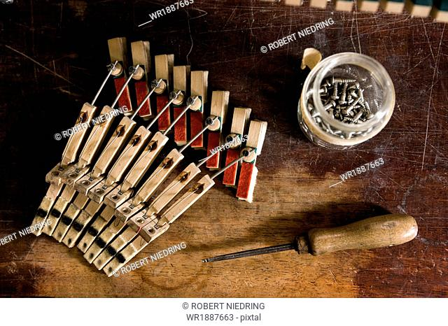 Musical mechanism of a piano alongside work tool, Regensburg, Bavaria, Germany