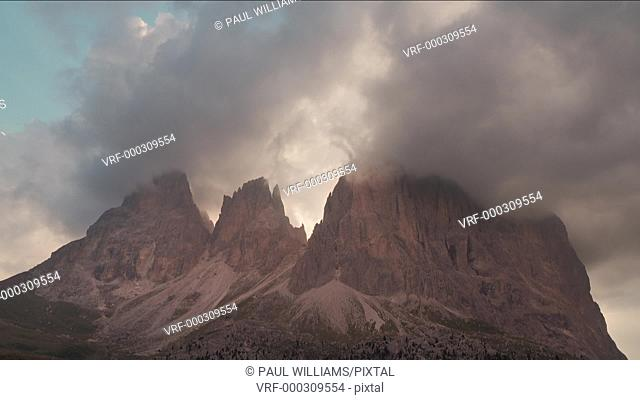 Timelapse of Cloudes at sunrise over Sassolungo Mountain range from the Sulla Pass, Dolomites, Italy