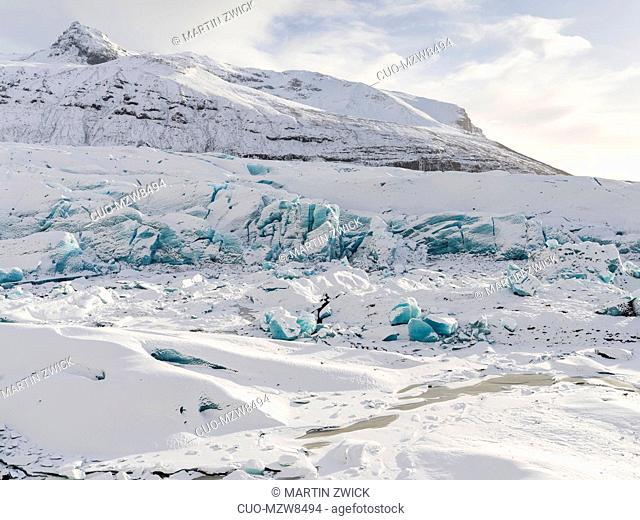 Glacier Svinafellsjoekull in Vatnajoekull NP in winter in Iceland. Glacier front and frozen glacial lake. Europe, Northern Europe, Scandinavia, Iceland