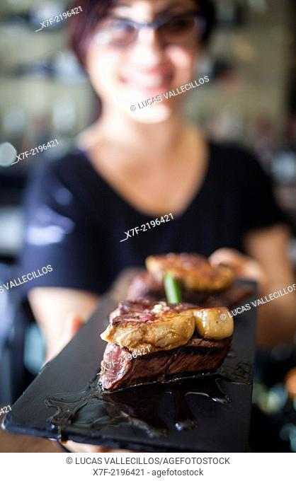 waitress shows a Tapa, Beef tenderloin