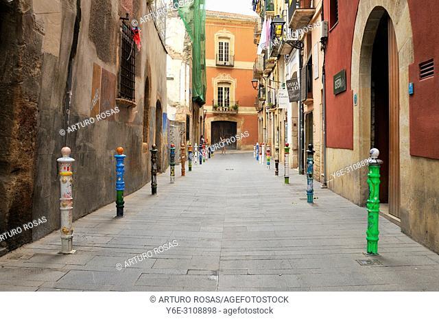 Street with bollards decorated in Tarragona. Catalonia, Spain