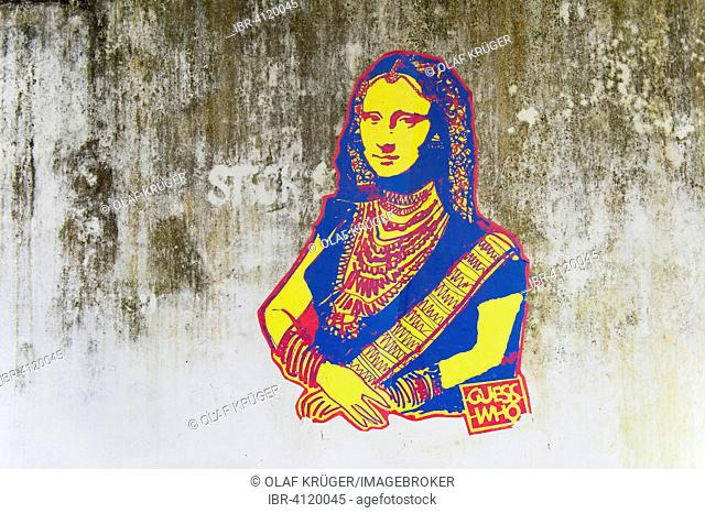 Leonardo da Vinci's Mona Lisa wearing an Indian Sari from the series Guess Who, unknown artist, graffiti on a wall in Kochi