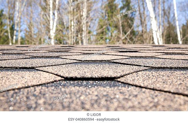 Modern roof covering, used instead of roof tiles and slate - flexible tile. Photo close-up, little depth of field. Focus in the middle photo