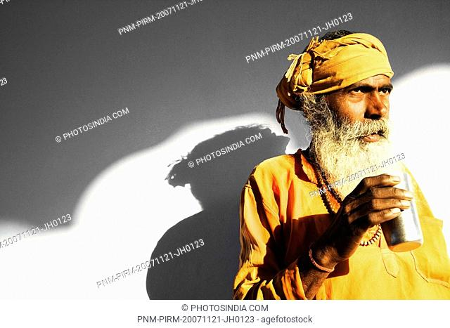 Close-up of a sadhu drinking water, Pushkar, Ajmer, Rajasthan, India