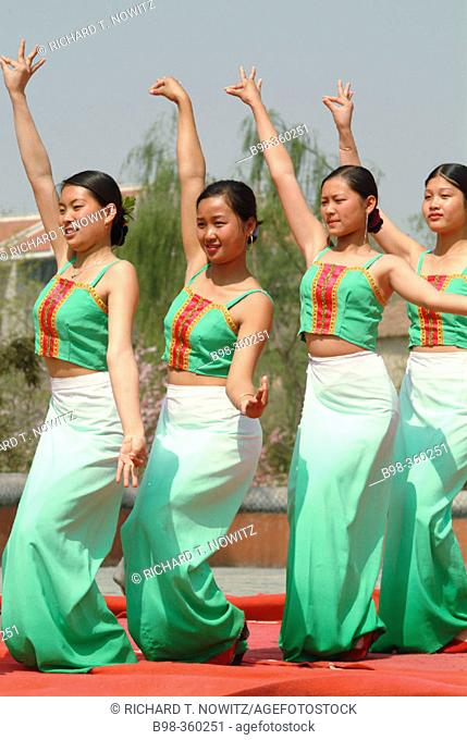 Dancers performing at Chinese Ethnic Cultural Park. Beijing, China