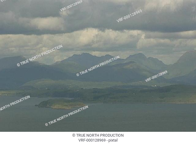 GV, wide shot of lake by mountains, cloudy, calm tranquil, peaceful, idyllic, picture postcard. Mull, Scotland, UK