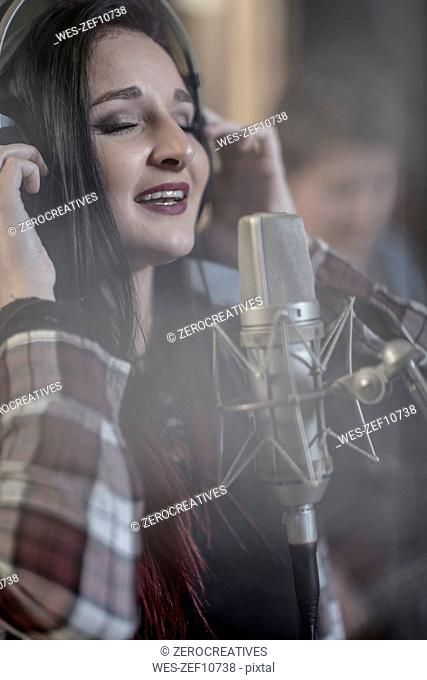 Singer at recording studio
